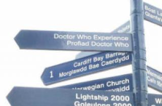 A sign post including a Dr Who experience sign in Cardiff