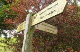 Wooden sign for the National Botanic Garden of Wales