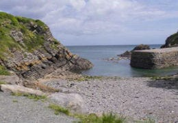 Stackpole Quay with shingle beach and sea
