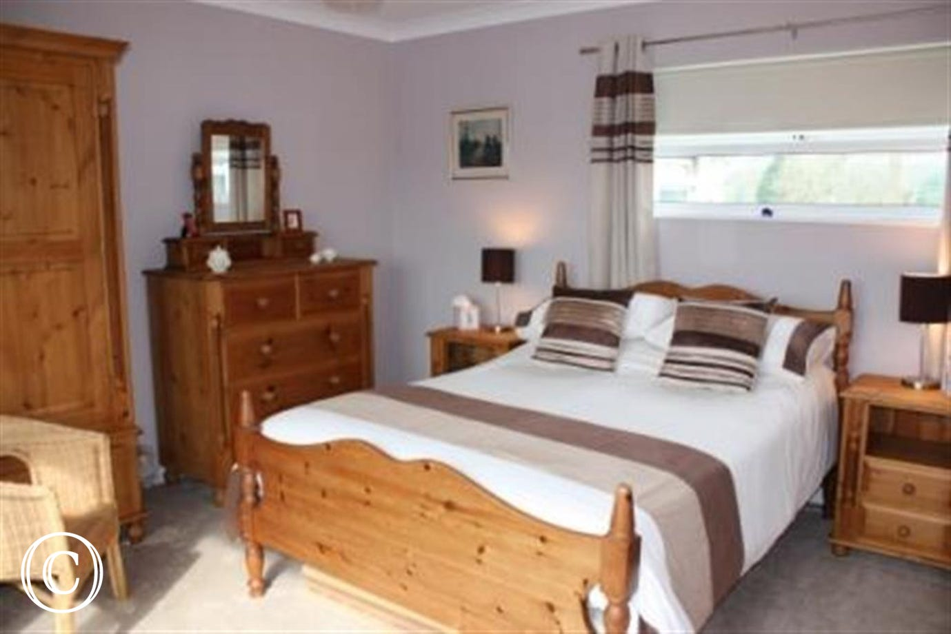Spacious double bedroom with en-suite bathroom, beds made up for your arrival