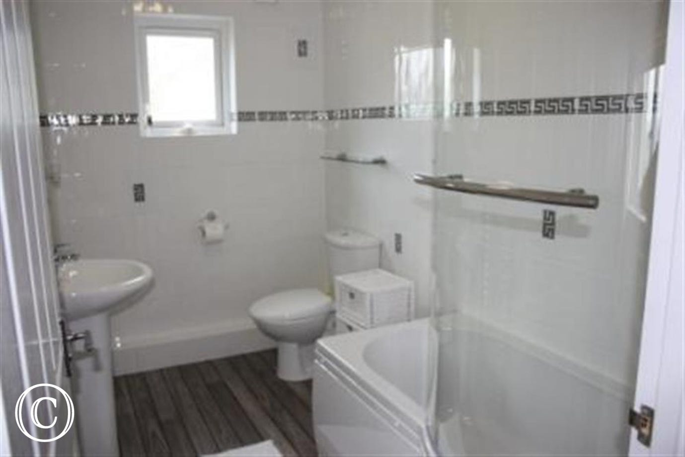 Modern en-suite bathroom with bath/shower over, whb and toilet