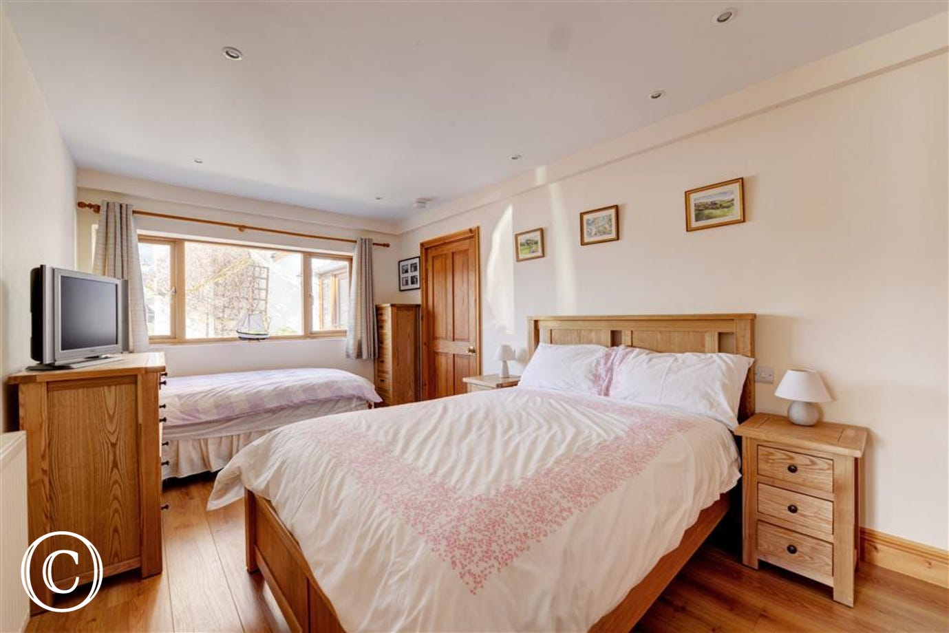 Double bedded room with a double and a single bed.