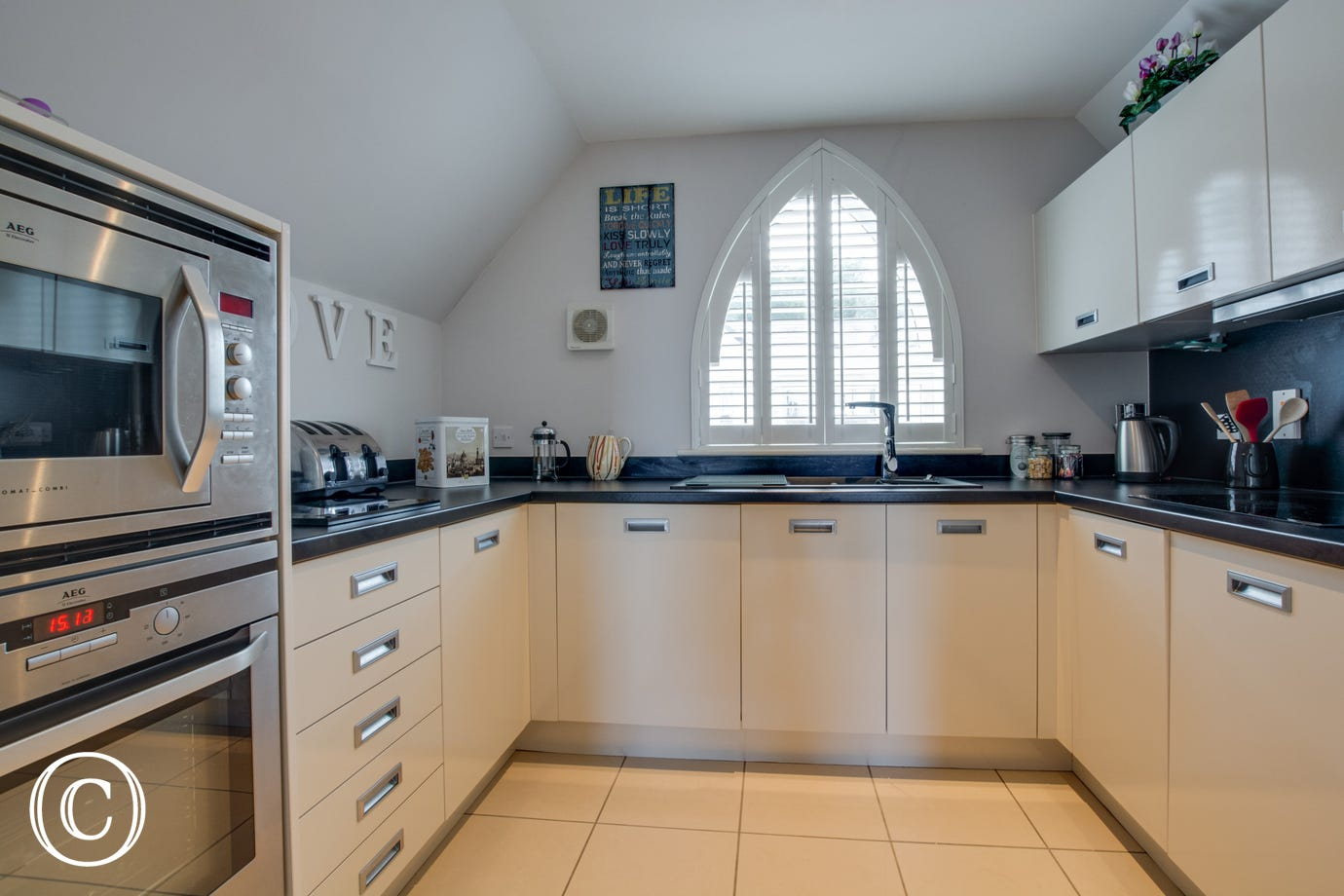 Well-equipped kitchen with a modern feel in this holiday accommodation