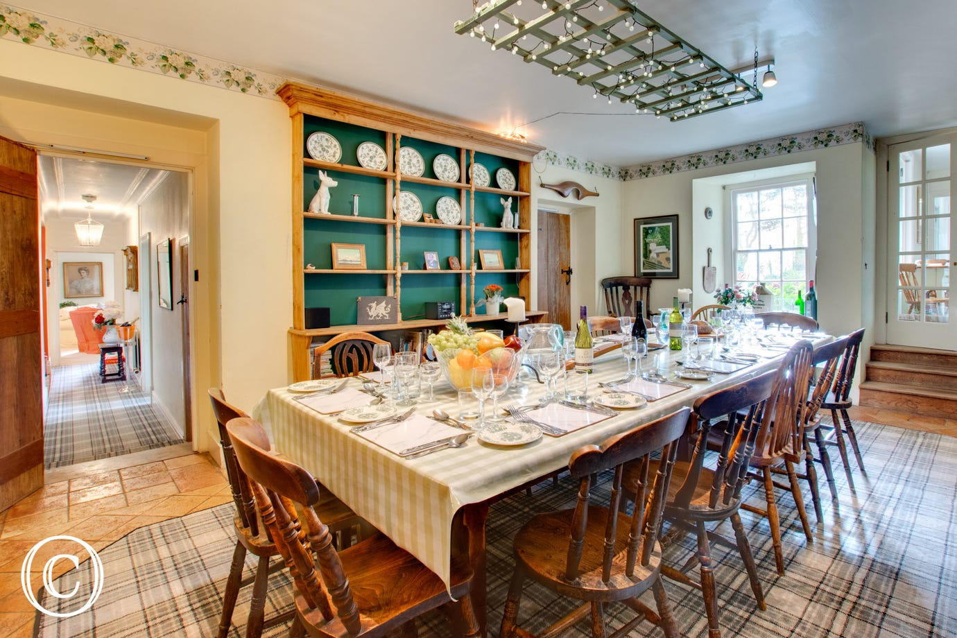 Farmhouse style dining room with four oven AGA giving a warm welcome in any season!