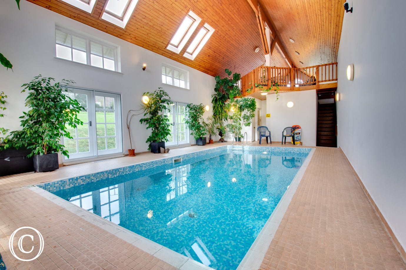 A stunning private pool with large indoor sun balcony.
