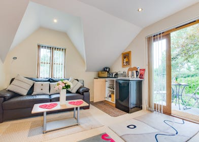 Lounge and kitchen area, with limited facilities at this quirky self catering apartment.
