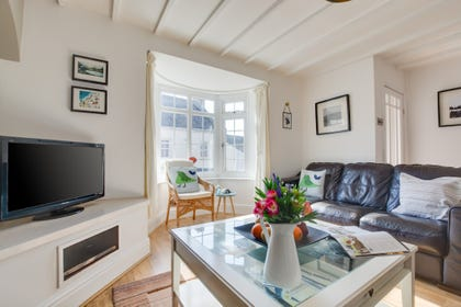 Self catering Saundersfoot property has comfortable lounge area.