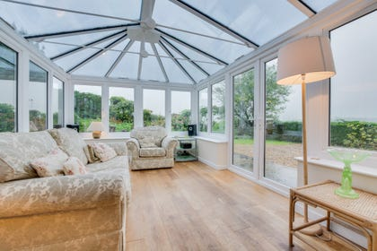 Holiday accommodation with conservatory with garden views.
