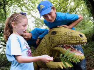 Children playing with a dinosaur