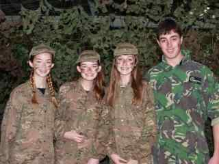 Group of children wearing camouflage gear