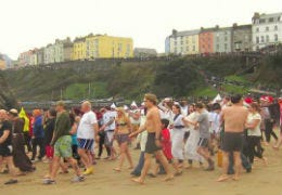 People on the beach waiting for the Tenby Boxing Day swim